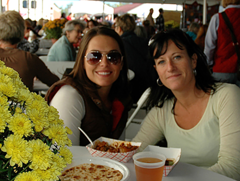 The Festival Dining Tent, with its unbelievable array of delicious flavors from around the world, is a favorite meeting place for friends taking a break at the show.