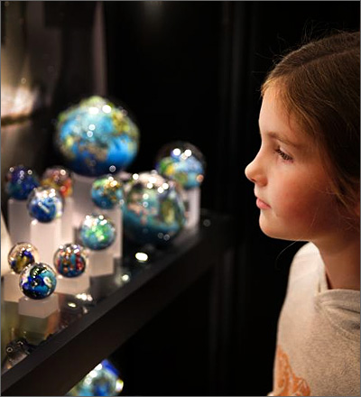 Young visitor admires Simpson Planets
